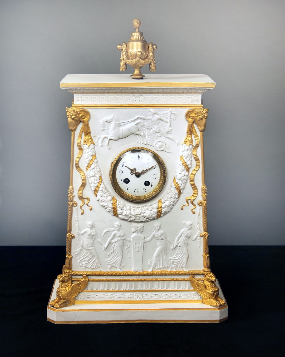 Late 19th Century Gilt Bronze Mounted Parcel-Gilt and Biscuit Porcelain Mantle Clock with Apollo