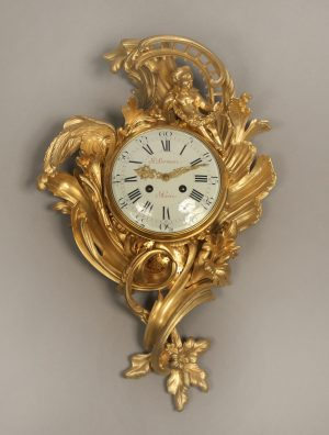 Late 19th Century Louis XV Style Gilt Bronze Cartel Clock with Foliage Designs By Paul Sormani