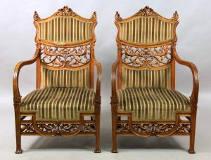 A Beautiful Pair of Early 20th Century Art Nouveau Carved Wood Arm Chairs with High Wavy Arms