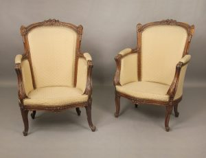 Pair of Late 19th Century Louis XV Style Carved Wood Bergeres with High Backs and Hand Carved Floral